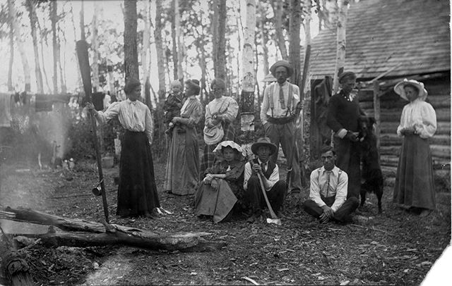 Some of my relatives in 1909.  My great grandmother is sitting on the ground beside the guy with the axe.  This is in Saskatchewan, Canada ?? My great grandmother Maggie Bullock is wearing the plaid skirt.  Great uncle Fred (holding an axe). The man sitting on their left, cross-legged is probably Jake Budge. I think the man with the dog could be my great grandfather and the woman beside him is probably Jessie Ransom. The woman in the plaid skirt behind my grandmother is my great great aunt, Maggie Clark Bullock. That could be my great grandmother standing on the left holding an oar.  And I don't know the dogs name but he's standing on his hind legs and that's pretty cool.